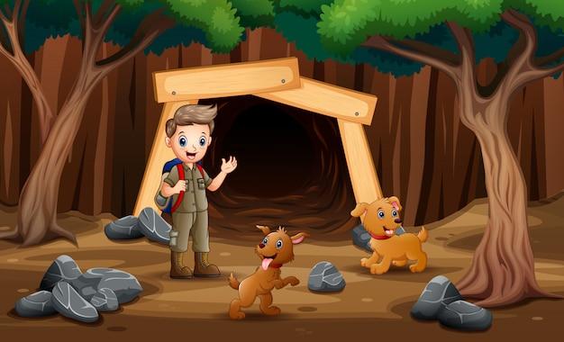 Cena com crianças escoteiras, caminhadas na mina com cães Vetor Premium