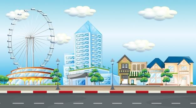 Cena da cidade com a roda gigante e edifícios Vetor grátis