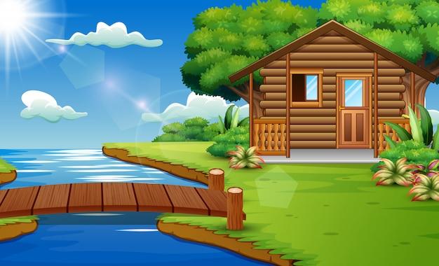 Cena da natureza com casas de madeira na beira do rio Vetor Premium