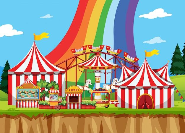 Cena de circo com arco-íris no céu Vetor grátis