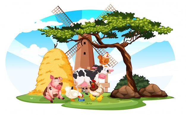 Cena de fazenda com animais e moinho de vento na fazenda Vetor grátis