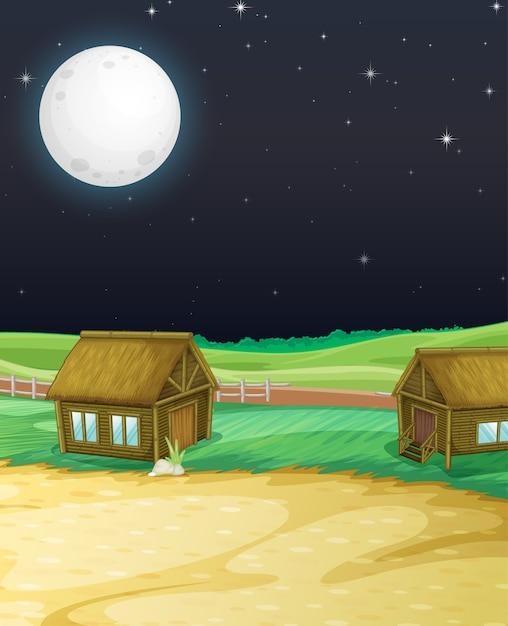 Cena de fazenda com celeiro e moinho à noite Vetor grátis