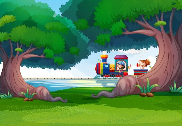 Cena de floresta com crianças no trem Vetor grátis