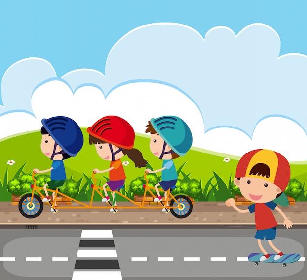 Cena de fundo com crianças andando de bicicleta na estrada Vetor Premium