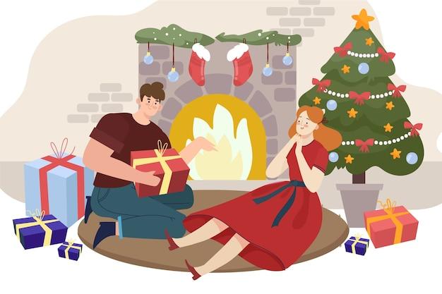 Cena de natal em família com homem oferecendo um presente Vetor grátis