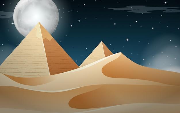 Cena do deserto da pirâmide de nightime Vetor grátis