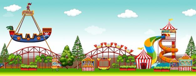 Cena do parque de diversões com passeios Vetor grátis