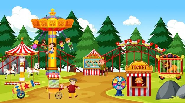 Cena do parque temático com muitos passeios e muitas pessoas Vetor grátis