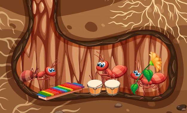 Cena subterrânea com formigas tocando música no buraco Vetor grátis