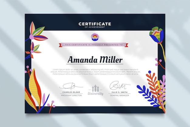 Certificado com modelo de folhas Vetor grátis