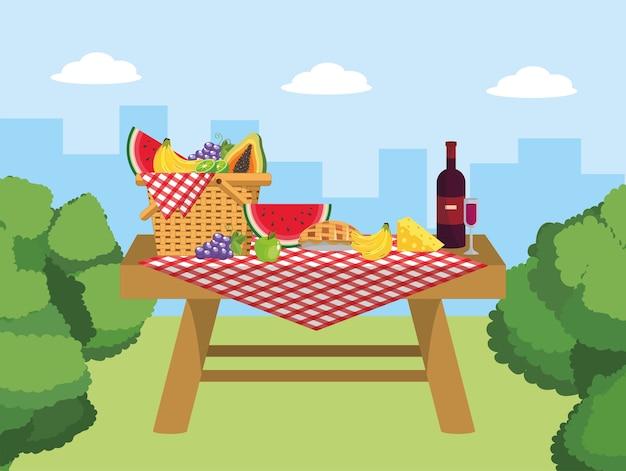 Cesta na mesa com comida de vinho e queijo Vetor Premium