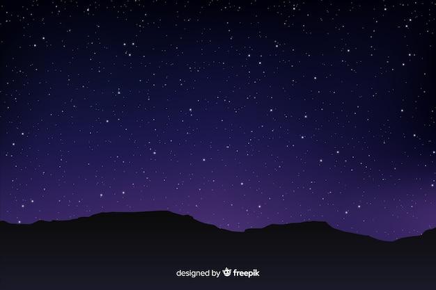 Céu noturno estrelado gradiente com montanhas Vetor grátis