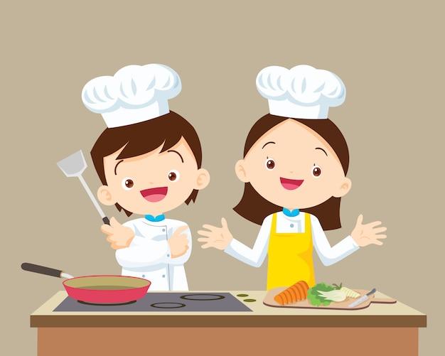 Chef bonitinho menino e menina Vetor Premium