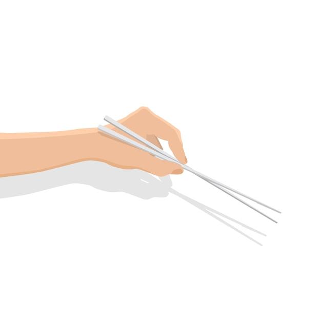 Chopsticks do uso da mão no fundo branco. Vetor Premium