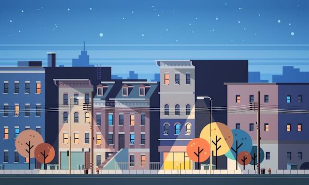 Cidade construção casas visão noturna horizonte plano de fundo Vetor Premium