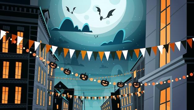 Cidade decorada para a celebração do dia das bruxas, com abóboras, guirlandas noite festa conceito Vetor Premium