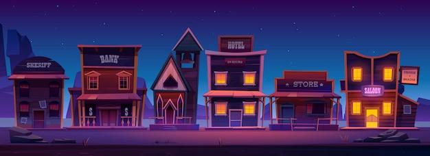 Cidade ocidental com edifícios antigos à noite Vetor grátis