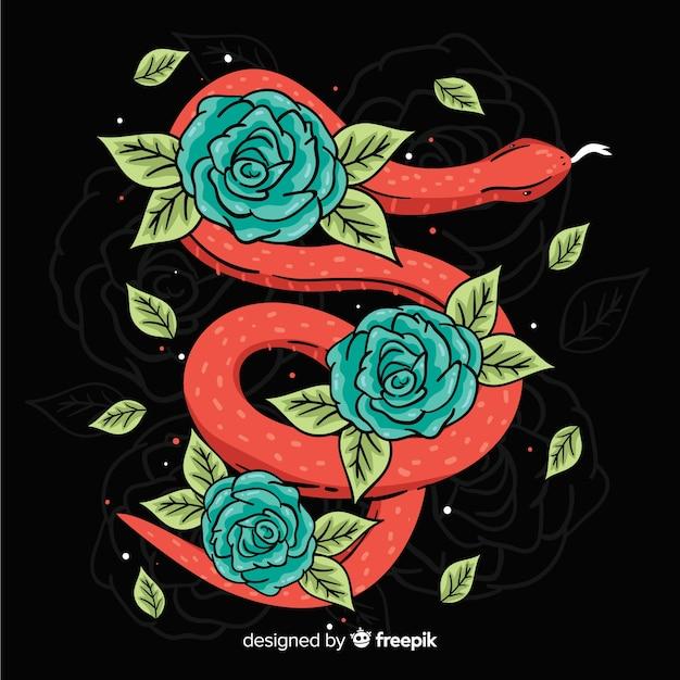 Cobra desenhada de mão com flores Vetor grátis
