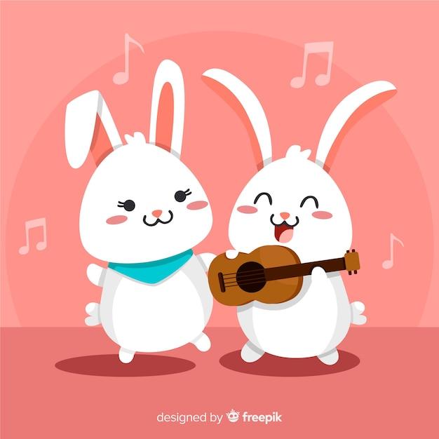 Coelhinhos kawaii cantando fundo Vetor grátis