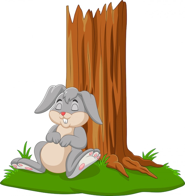 Coelho de desenho animado dormindo debaixo da árvore Vetor Premium