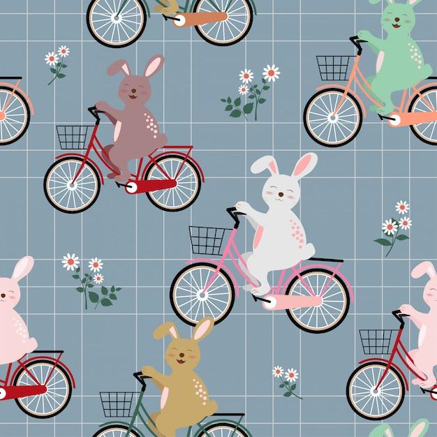 Coelhos a gangue no padrão sem emenda de bicicleta colorida Vetor Premium