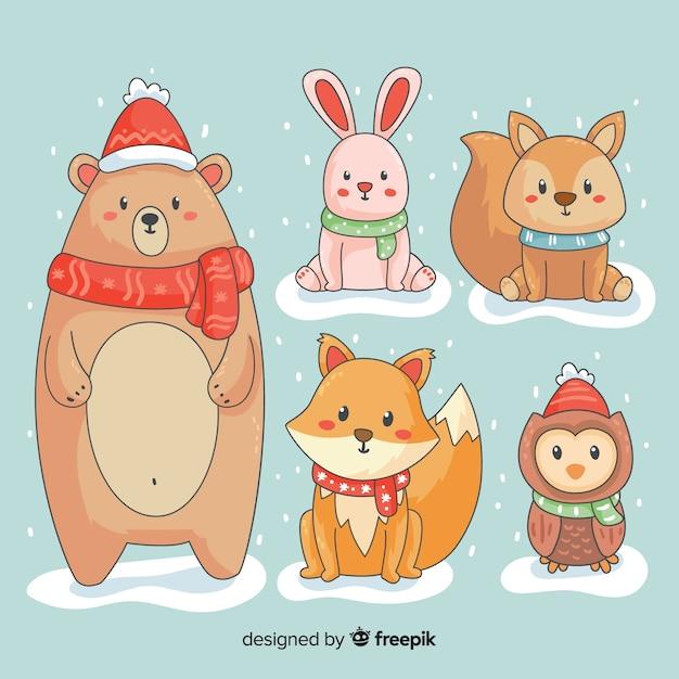 Coleção de animais dos desenhos animados de inverno Vetor grátis