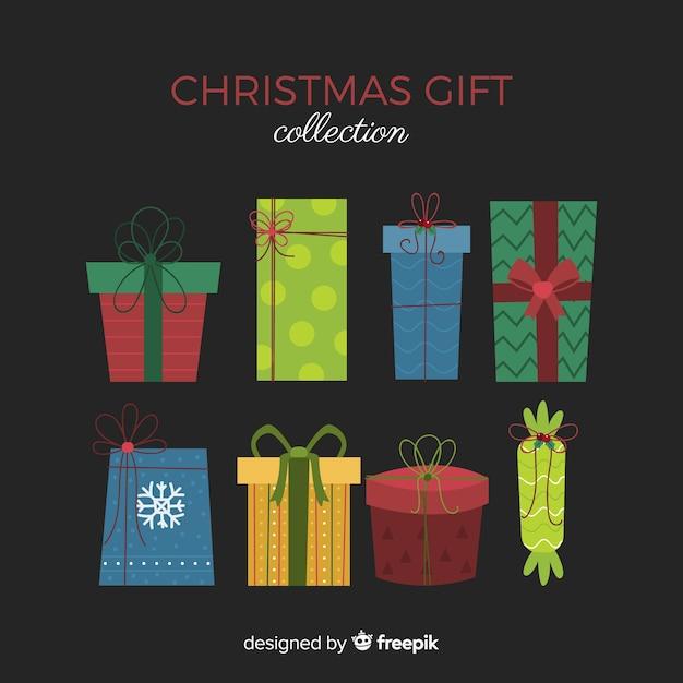 Coleção de caixa de presente de natal em design plano Vetor grátis