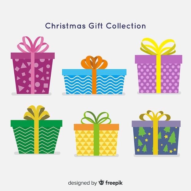 Coleção de caixas de presente de natal colorido em design plano Vetor grátis
