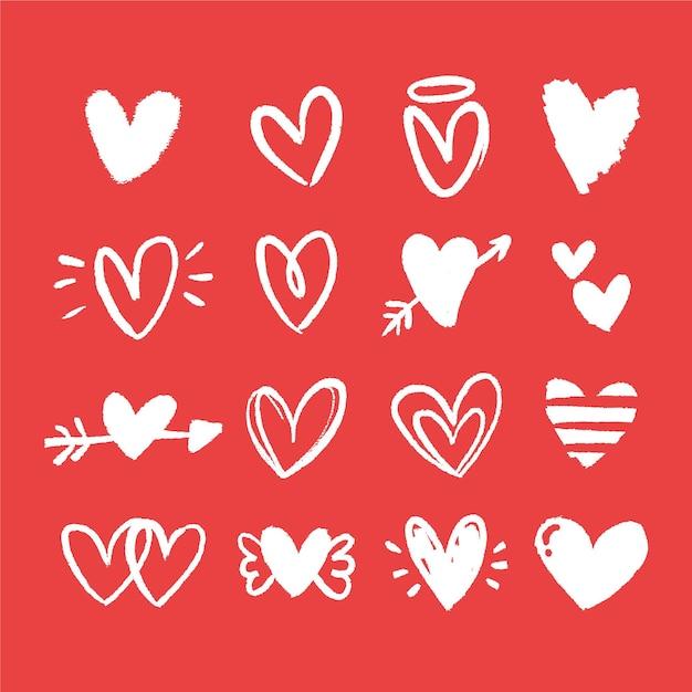Coleção de coração desenhada à mão Vetor grátis