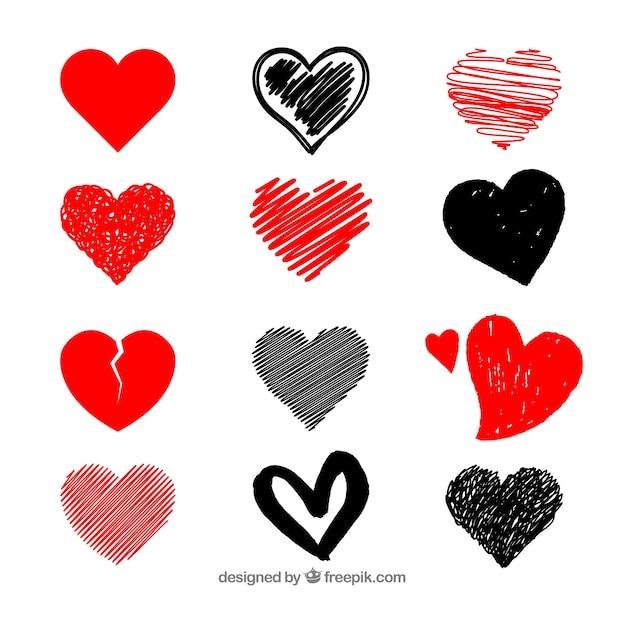 Coleção de coração desenhada mão Vetor grátis