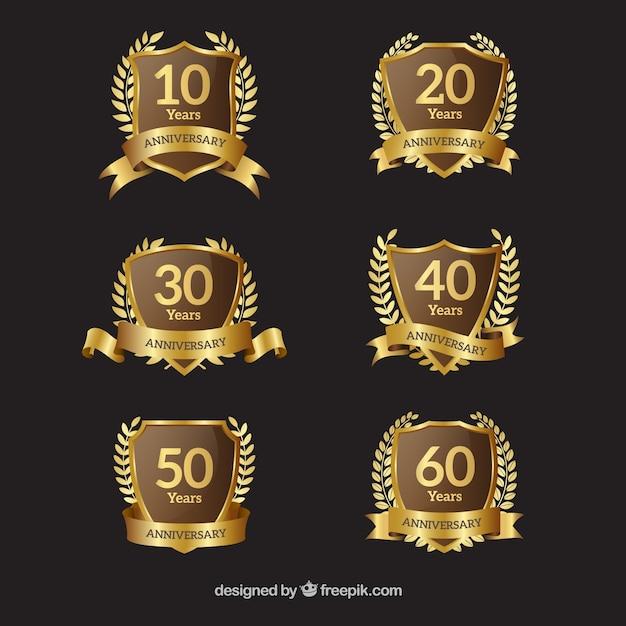Coleção de emblemas de ouro aniversário com coroa de louros Vetor grátis