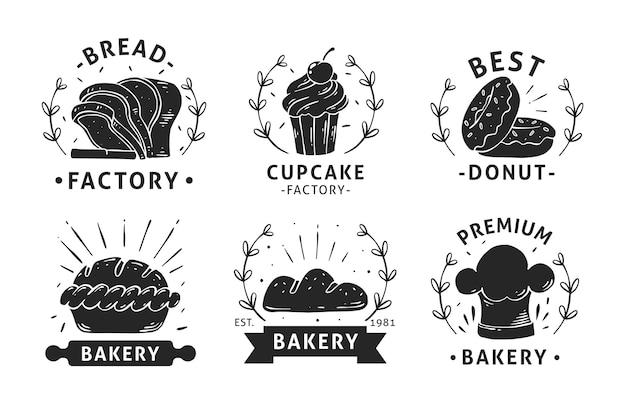 Coleção de emblemas de padaria desenhados à mão Vetor Premium