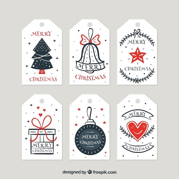 Coleção de etiquetas de natal desenhadas a mão retro Vetor grátis