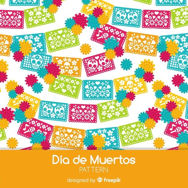 Coleção de padrão colorido día de muertos com design plano Vetor grátis