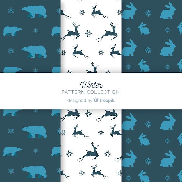 Coleção de padrão de inverno silhuetas animais Vetor grátis