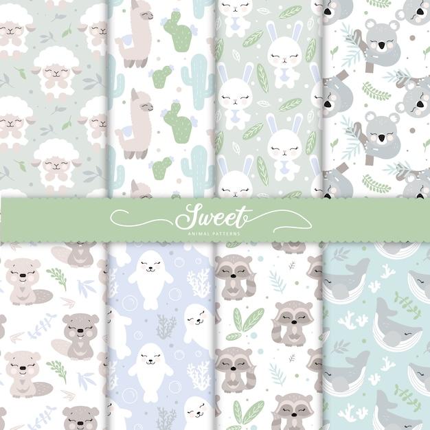 Coleção de padrões animais de bebê dos desenhos animados para papel de parede bebê Vetor Premium