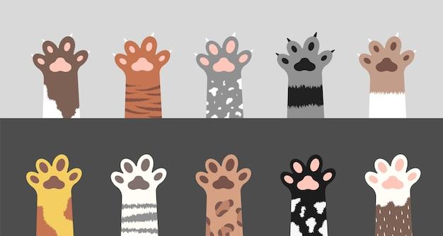Coleção de patas fofas de gato. conjunto de silhuetas de pés de gatinho fofo. Vetor Premium