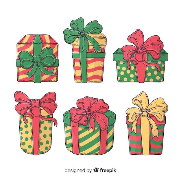 Coleção de presente de natal desenhada de mão Vetor grátis