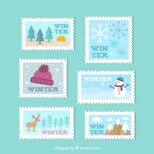 Coleção de selos de inverno em design plano Vetor grátis