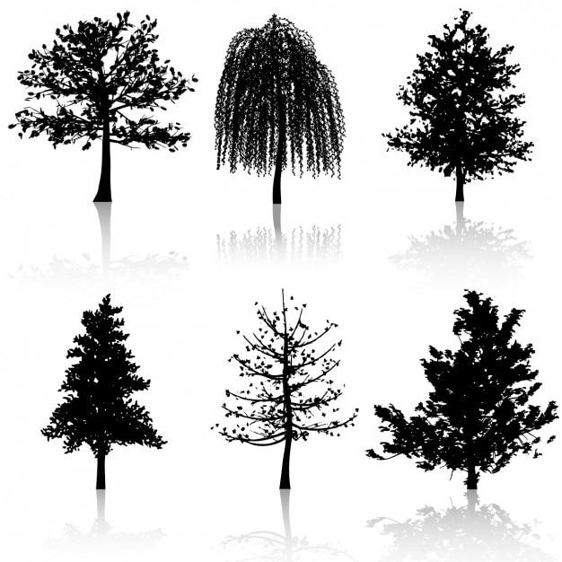 Coleção de silhuetas de árvores Vetor grátis