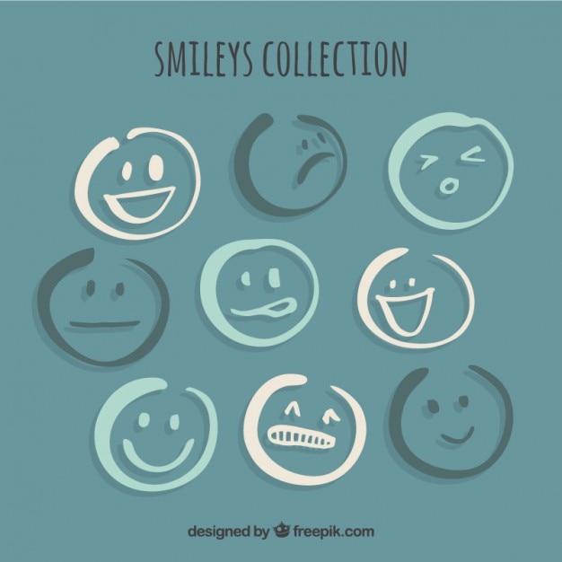Coleção de smileys esboços Vetor grátis
