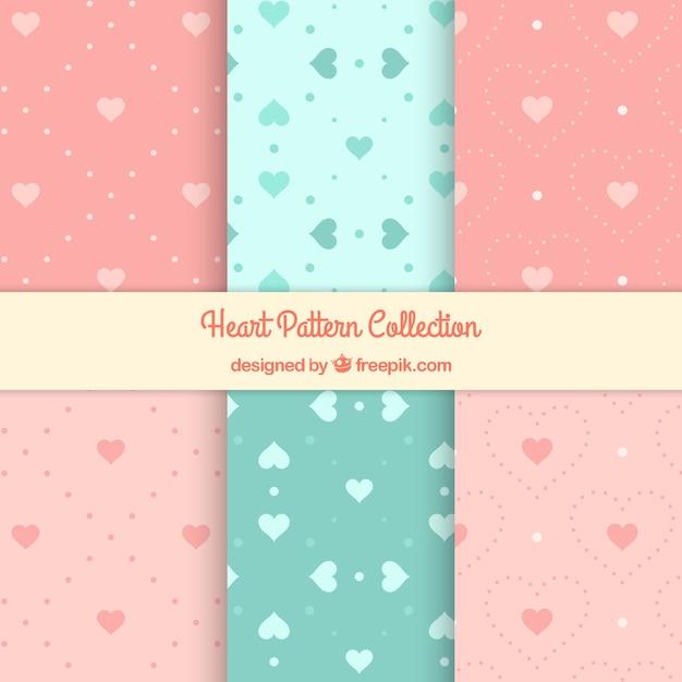 Coleção de testes padrões corações decorativos Vetor Premium