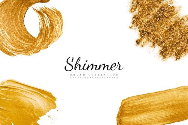 Coleção de traços de pincel de ouro Vetor grátis
