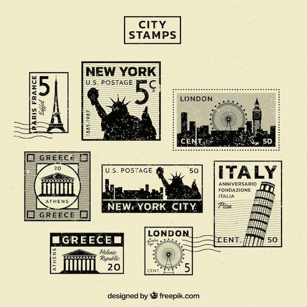 Coleção do vintage de selos de cidades diferentes Vetor grátis