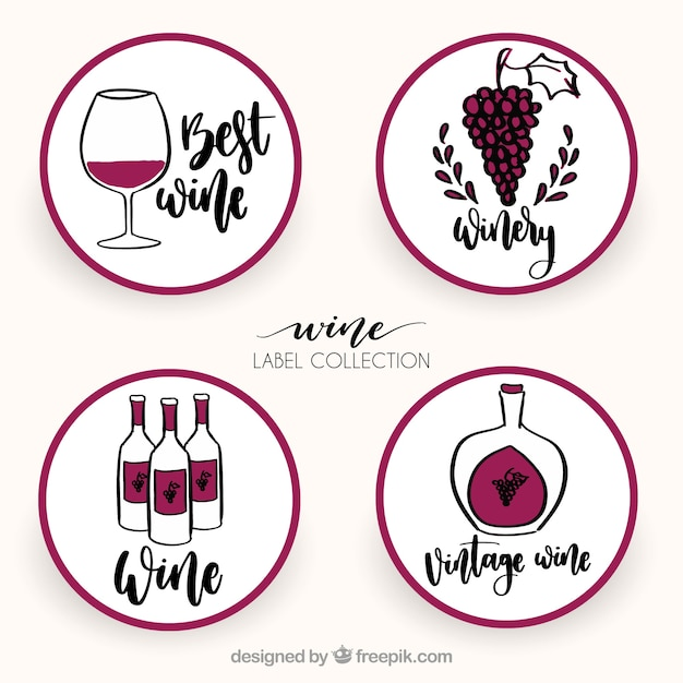 Coleção hand-drawn de quatro etiquetas redondas do vinho Vetor grátis