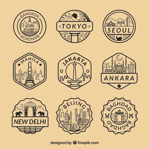 Coleção plana de selos fantásticos com diferentes cidades Vetor grátis