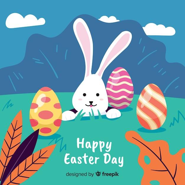 Colocação de mão desenhada coelho fundo de dia de páscoa Vetor grátis