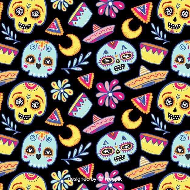 Colorido padrão de día de muertos com caveiras Vetor grátis