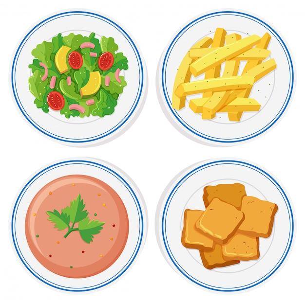 Comida diferente nas placas Vetor grátis