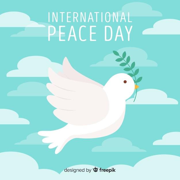 Composição do dia da paz com pomba branca plana Vetor grátis